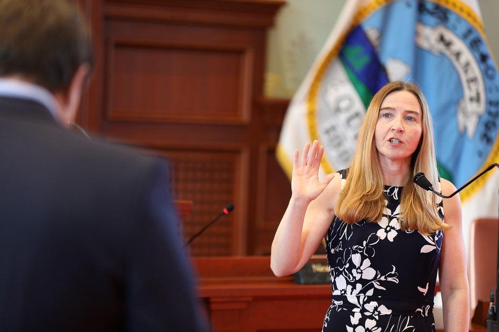 Courtney Perdios is sworn in as a member of the Quincy School Committee Wednesday morning by Mayor Thomas Koch at a brief ceremony held in the Great Hall of the James R. McIntyre Government Center (old City Hall). Perdios was appointed to the vacant school seat created when Anthony Andronico was appointed to the Ward 2 city council seat after former councillor Brad Croall resiigned last month. Photo Courtesy Lisa Aimola/City of Quincy
